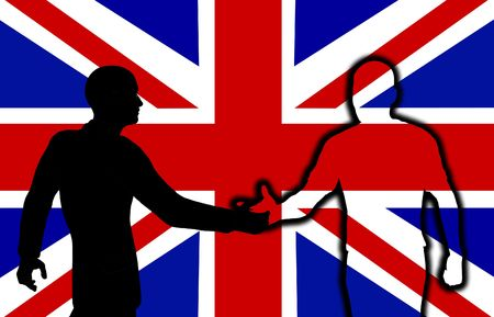 Silhouetted men shaking hands in front of the British flag. photo
