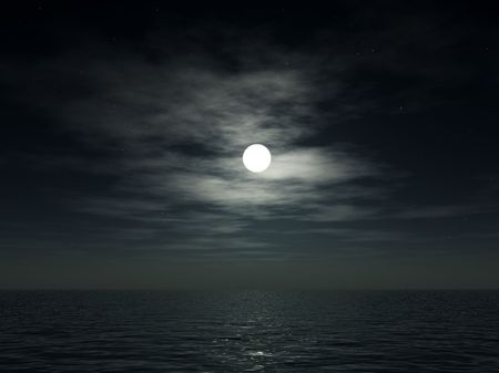 The moon over a cloudy nighttime ocean. Stock Photo