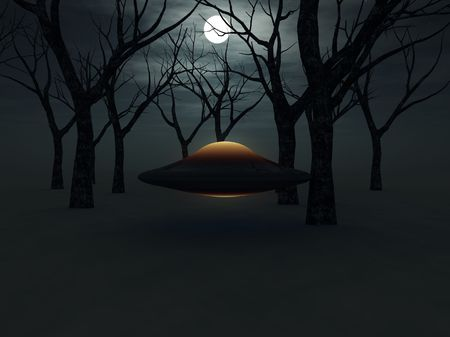 A UFO hovering in a forest. photo