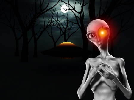 extra terrestrial: An alien and a UFO in a dark forest. Stock Photo