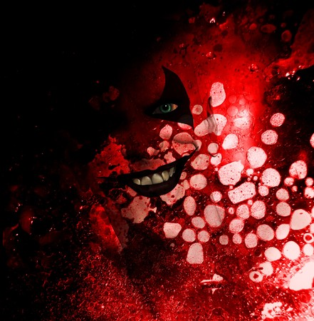 clownophobia: Sinister grinning clown behind a layer of bloodstained texture.