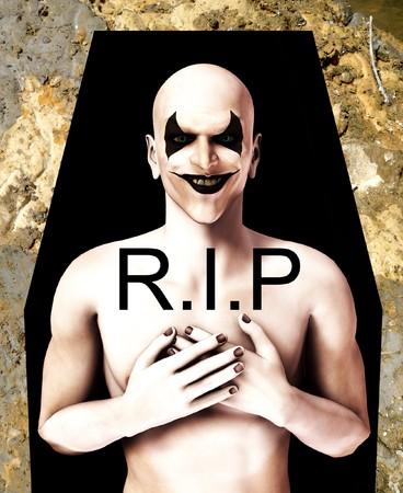 clownophobia: Una imagen de un payaso muerto mal en un ata�d.  Foto de archivo