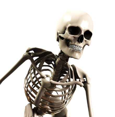 A skeleton that is bending forward, suitable for Halloween or medical concepts.