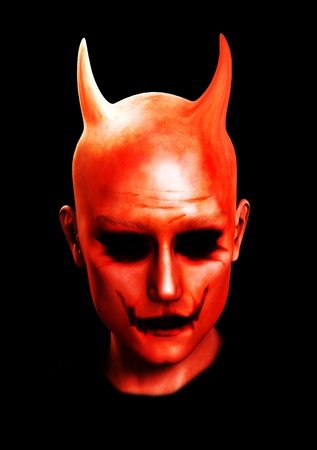 The face of the devil for Halloween and horror concepts.  photo