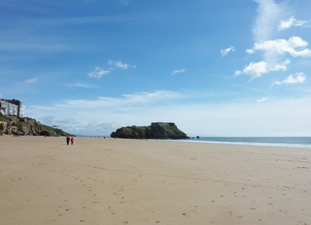 A view of the massive costal rock future on Tenby beach Stock Photo - 9448373