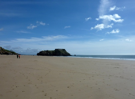 A view of the massive costal rock future on Tenby beach Stock Photo - 9448372
