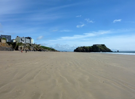 tenby wales: A view of the massive costal rock future on Tenby beach Stock Photo