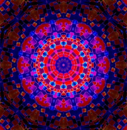 A Bright multicoloured Kaleidoscopic wallpaper pattern background.  photo