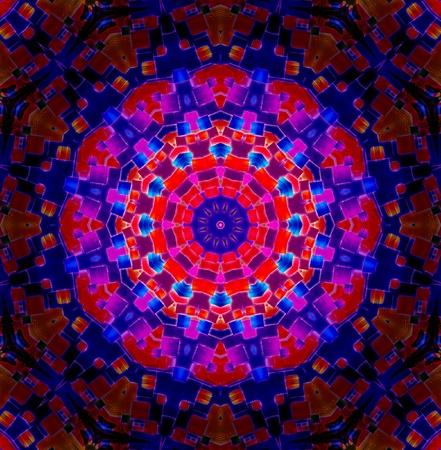 A Bright multicoloured Kaleidoscopic wallpaper pattern background.  photo