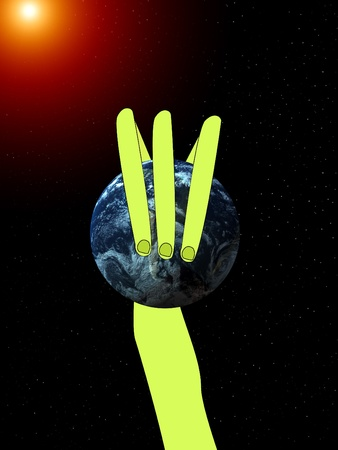 extra terrestrial: Conceptual image showing an alien hand that is grabbing the world.