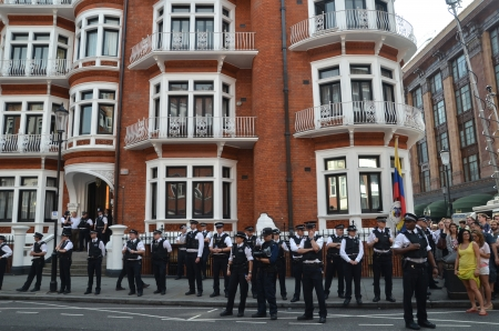 policing: London � August 19: Police Watch Julian Assange Protest Outside The Ecuadorian Embassy London August 19th, 2012 in London, England. Editorial