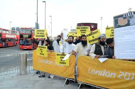 London � August 12: Radical Muslim Protesters outside the closing ceremony at the Olympic Stadium  In London  August 12th, 2012 in London, England. Stock Photo - 15837202