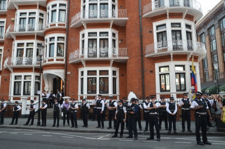 policing: London – August 19: Police Watch Julian Assange Protest Outside The Ecuadorian Embassy London August 19th, 2012 in London, England. Editorial