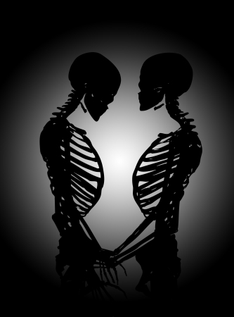 Male and female skeleton in a loving pose. photo