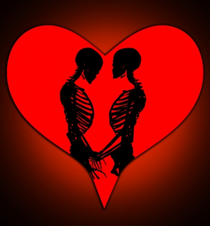 Male and female skeleton in a loving pose with a love heart. photo