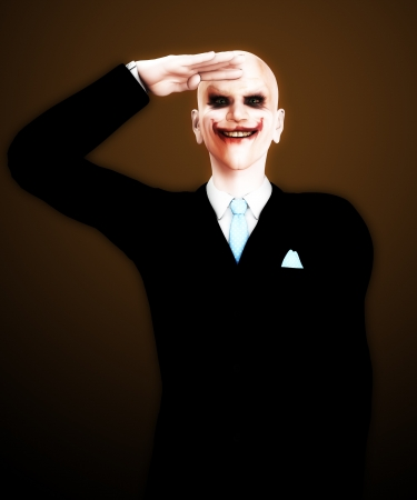 Evil clown figure that is saluting in a sinister way. Stock Photo