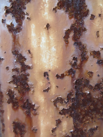oxidising: Close up of some rust on a metal pillar.