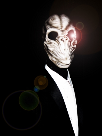 extra terrestrial: Alien form coming out of the darkness. Stock Photo