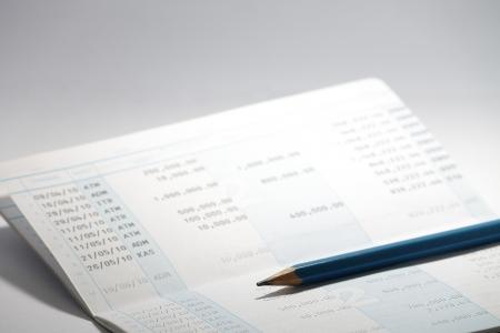 pencil above passbook