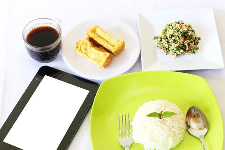 breakfast menu accompanied smartphones when going to work photo