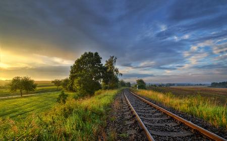 railtrack: September sunset on the tracks outside the city Stock Photo