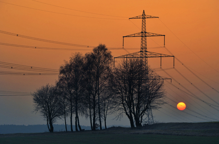 hight tech: March evening at the Bavarian countryside with sunset in high voltage Stock Photo