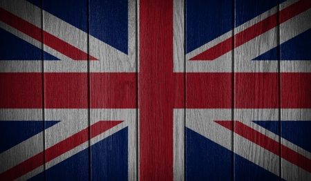 United Kingdom Flag painted on old wood plank background photo