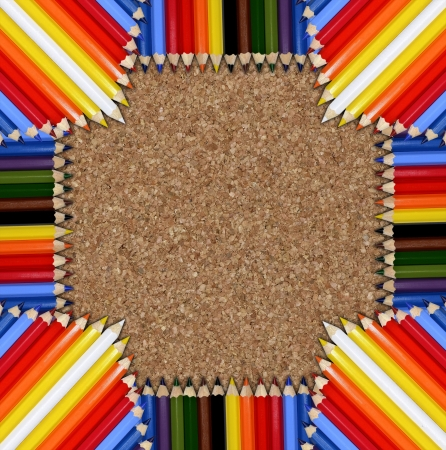 Color pencils on cork background photo