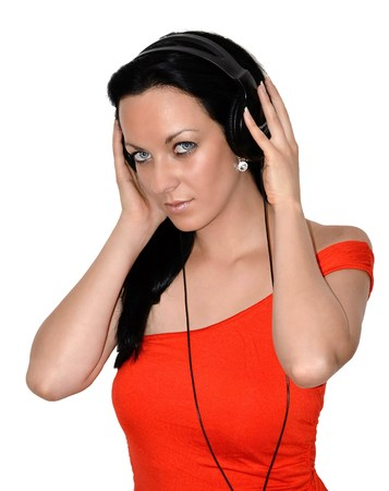 girl in orange t-shirt, listening to music in headphones, white background photo