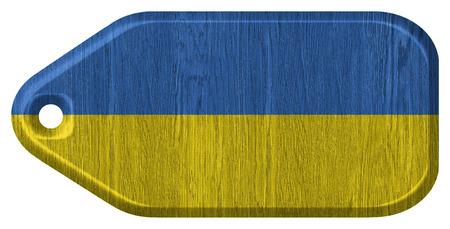 Ukraine flag painted on wooden tag