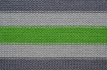 Knit woolen texture. Fabric striped background photo