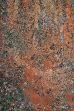 decorative wall: old spotty stained concrete wall texture background. color pattern. orange, red Stock Photo