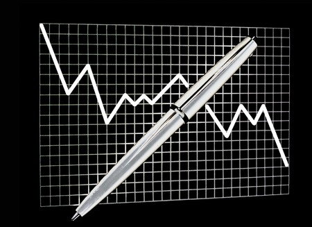 Chart on checked paper with a pen on isolated black background