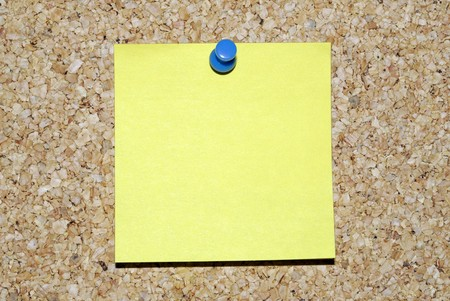 Blank yellow sticky note on corkboard Stock Photo - 4341469