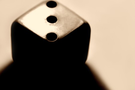Dice with harsh shadow