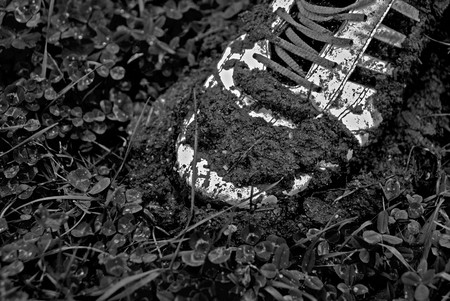 Old shoe stuck in mud photo