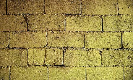Brick wall texture in yellow tone