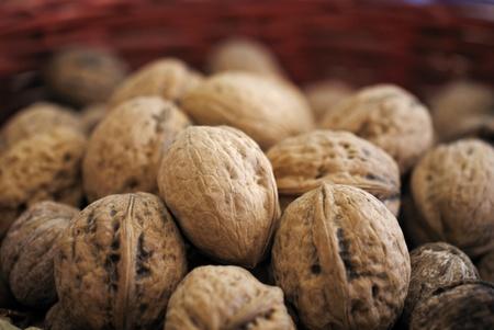 Walnuts in red wooden basket