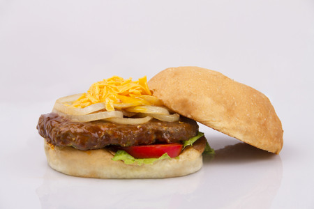 sandwitch: Burger sandwich with cheese, onions, tomatoes and lettuce Stock Photo