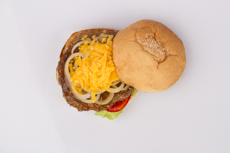 sandwitch: Top view of a burger sandwich with cheese