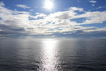 A picture of the sea, some clouds, and the sun. BC Canada