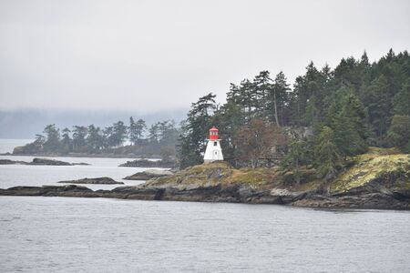 A picture of lighthouse on the point. BC Canada Stock fotó