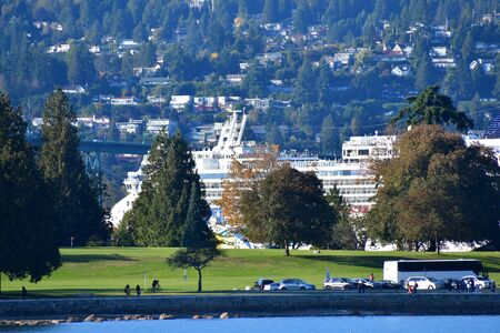 A view of cruise ship sailing by Stanley park. BC Canada