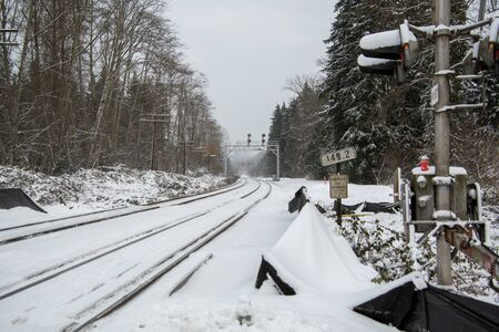 A picture of railway on the snow-covered ground.   Burnaby BC Canada 版權商用圖片 - 137848735