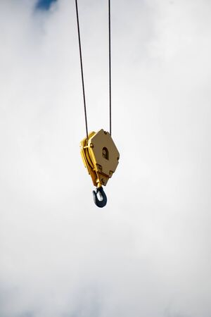 A picture of a crane hook against the sky. Vancouver BC Canada