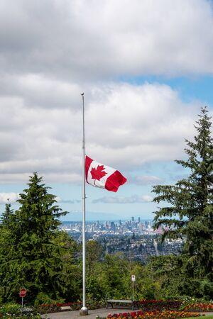 Canadian flag flying at half-mast. Vancouver BC Canada