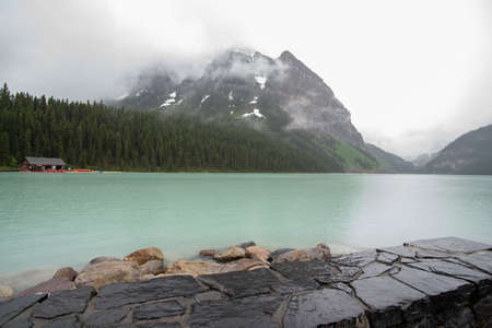 A picture of lake Louise and mountains taken on a rainy morning.   Banff National park  AB Canada Archivio Fotografico