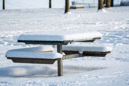 A picnic table in the park covered in snow.   Vancouver BC Canada