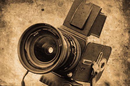 mangy: old photo camera in retro design look