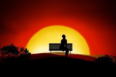 A person sitting alone on a bench in the sunset
